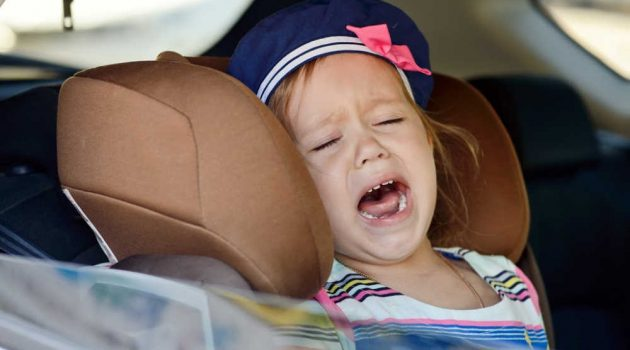 Girl crying in toddler carseat