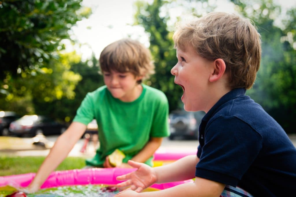 When summer hits, naturally parents want to avoid the summer slide. We want to schedule enough summer activities so that our children are challenged and go back to school ready. While all of this is done with the best of intentions, free play is more beneficial than most of these extracurricular activities for kids. This is why. Image kids engaged in free play outdoors during summer. Photo credit unsplash photography
