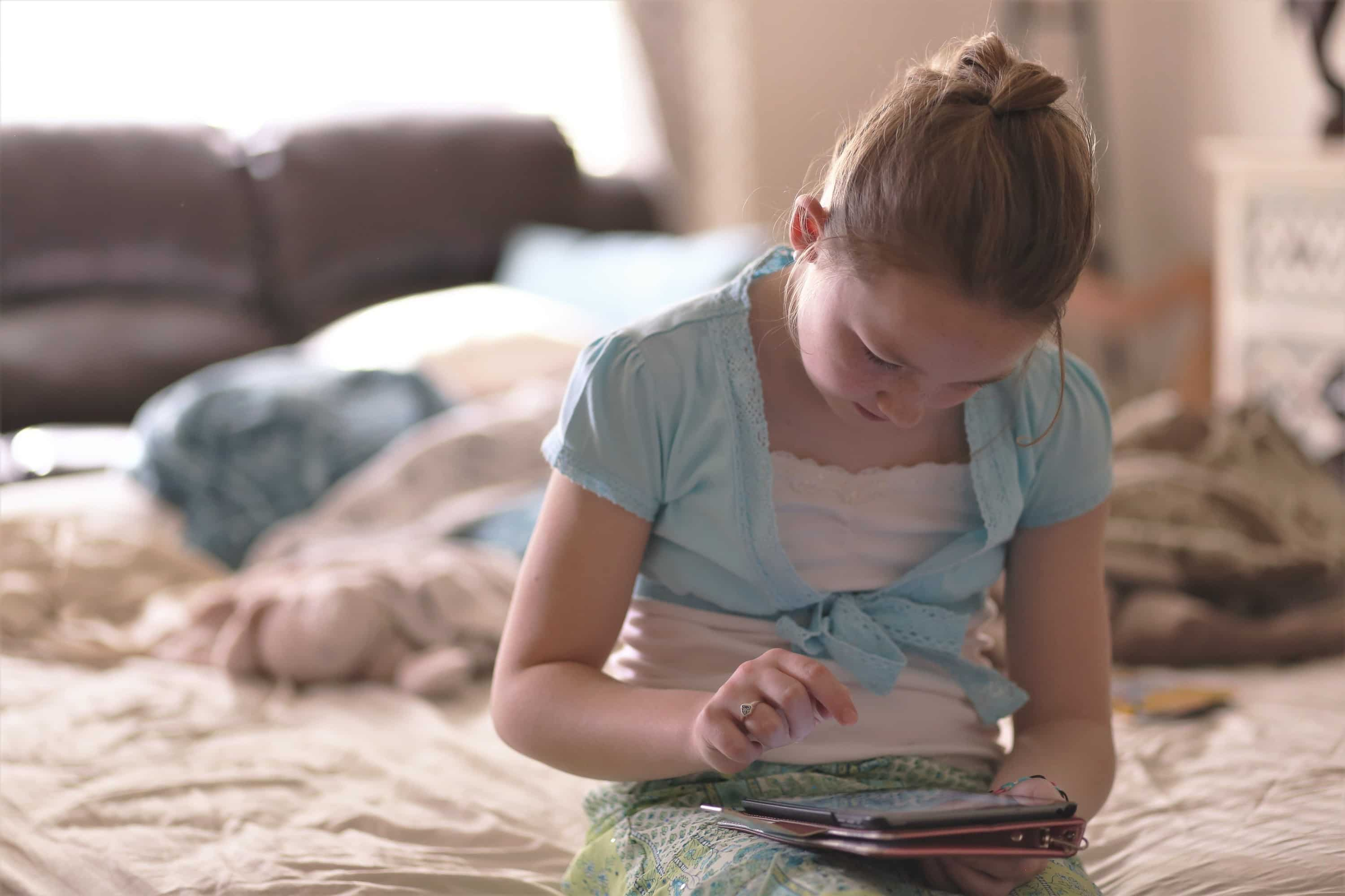 It can be maddening when kids don't listen. These are research-based strategies that will teach you how to get kids to listen calmly and effectively. Girl on iPad. Positive Discipline.