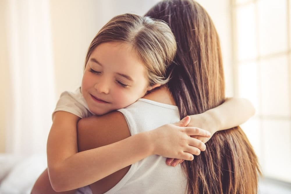 how to execute positive parenting with strength. Mother and daughter hugging